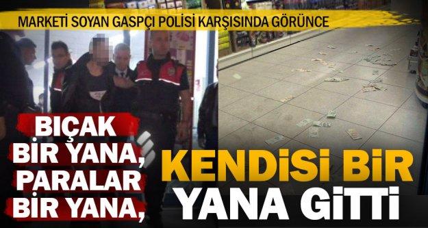 Polisi görünce cama çarpan gaspçı, paraları yere saçtı