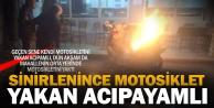 Üzerinden düştüğü motosikletini ateşe verdi