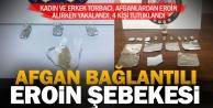 Afgan eroin toptancısı, torbacıya satış yaparken basıldı