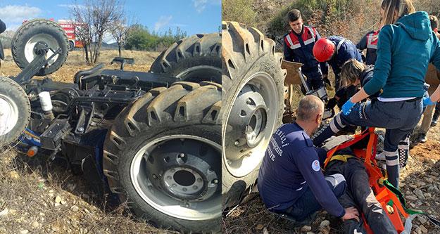 Çal'da kullandığı traktörün altında kalan sürücü ağır yaralandı